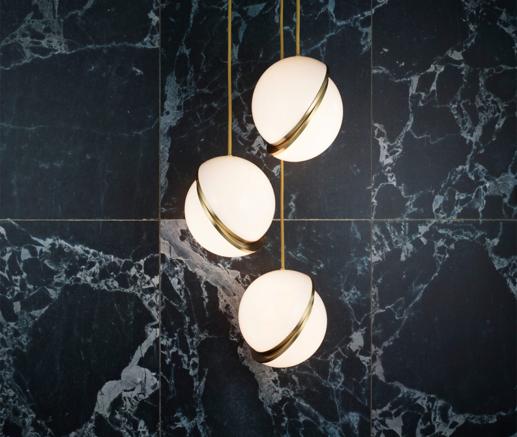 Eye on the ball: orb-shaped pendants ready to hit it home. Crescent lights by Lee Broom.