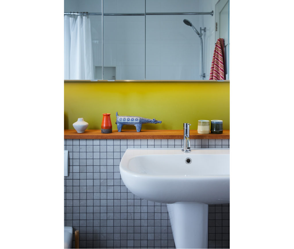 Mosaic tile from Ciot and chartreuse paint jazz up the bathroom. Cabano faucet from Taps.