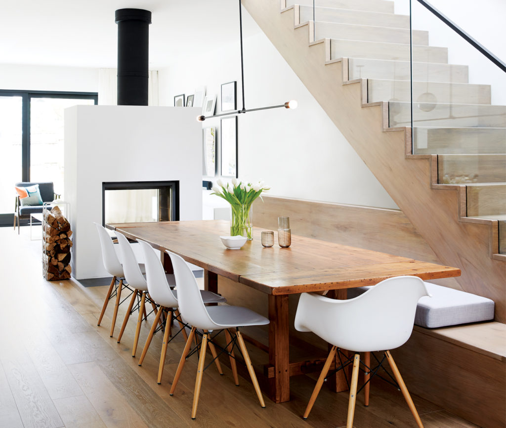 A four-metre-long bench joins the white oak staircase by R&A Stairs. Pendant from Deschênes Luminaire; dining table by Johnson's Antiques; fireplace from Igne Ferro.