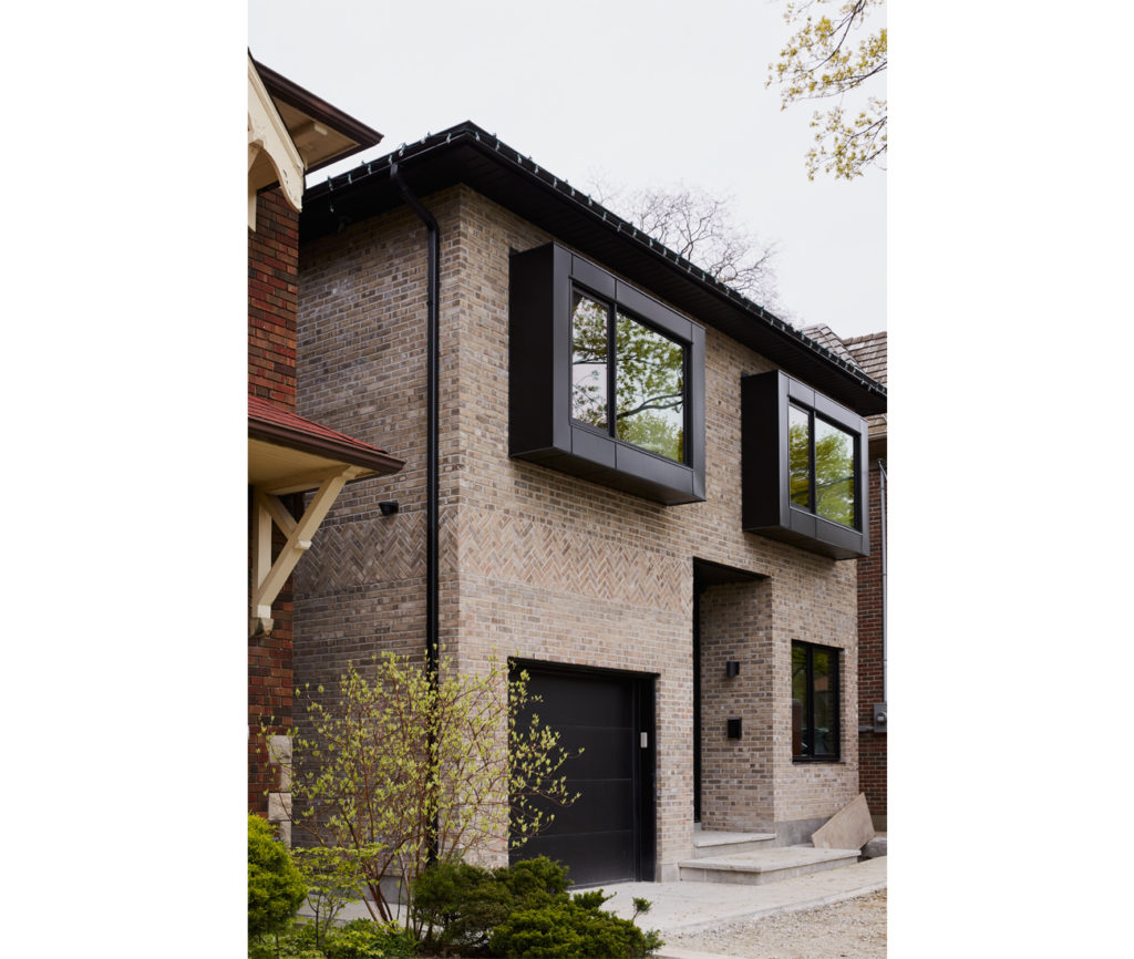 Aluminum-clad windows extend 45 centimetres from the Glen-Gery Brick facade to soak up southern rays.