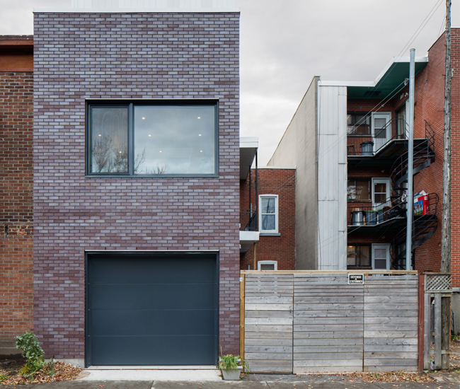 Microclimat, which Maston co-founded, built this Montreal home in a little under two years. Alumilex windows overlook its laneway and brighten the interior to its core. Photo by Adrien Williams.