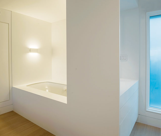 BainUltra tub in the master; all Corian work by Surface One.