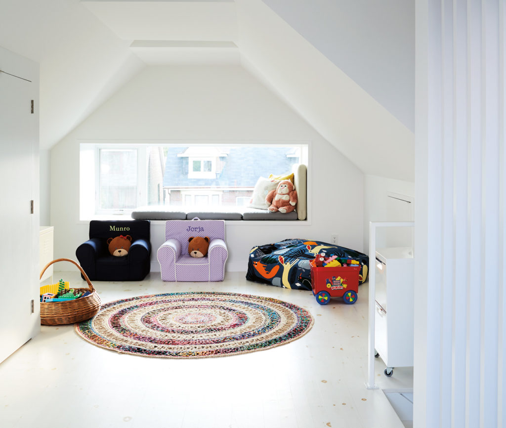 Once multiple rooms, the third floor is now home to a playroom with access to the rooftop deck. Beanbag chair from EQ3; rug from CB2.