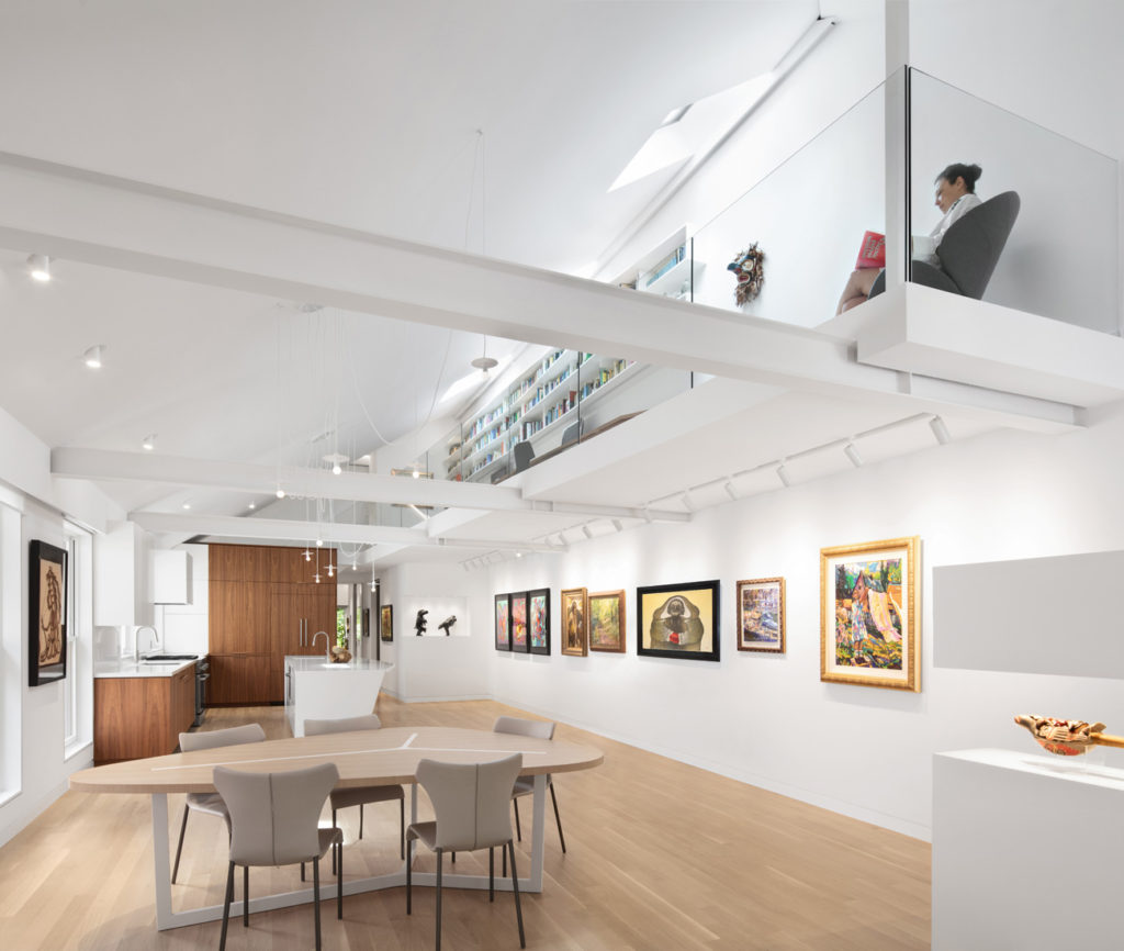 A mezzanine replaces an unused attic, with an office above and gallery below. Library by Derek Nicholson Inc., kitchen by B L Woodworking & Design, dining furniture from Kiosk, pendants from Klaus and oak flooring from First Class.
