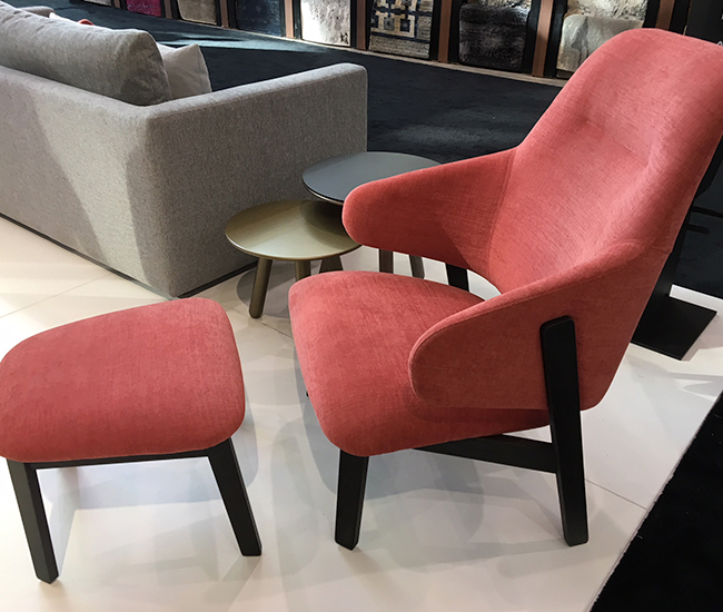 Wolfgang by Huppe. Here we have a raspberry pink armchair and matching ottoman that is so comfortable you'll want to hug it back. Designed by international Italian star Luca Nichetto.