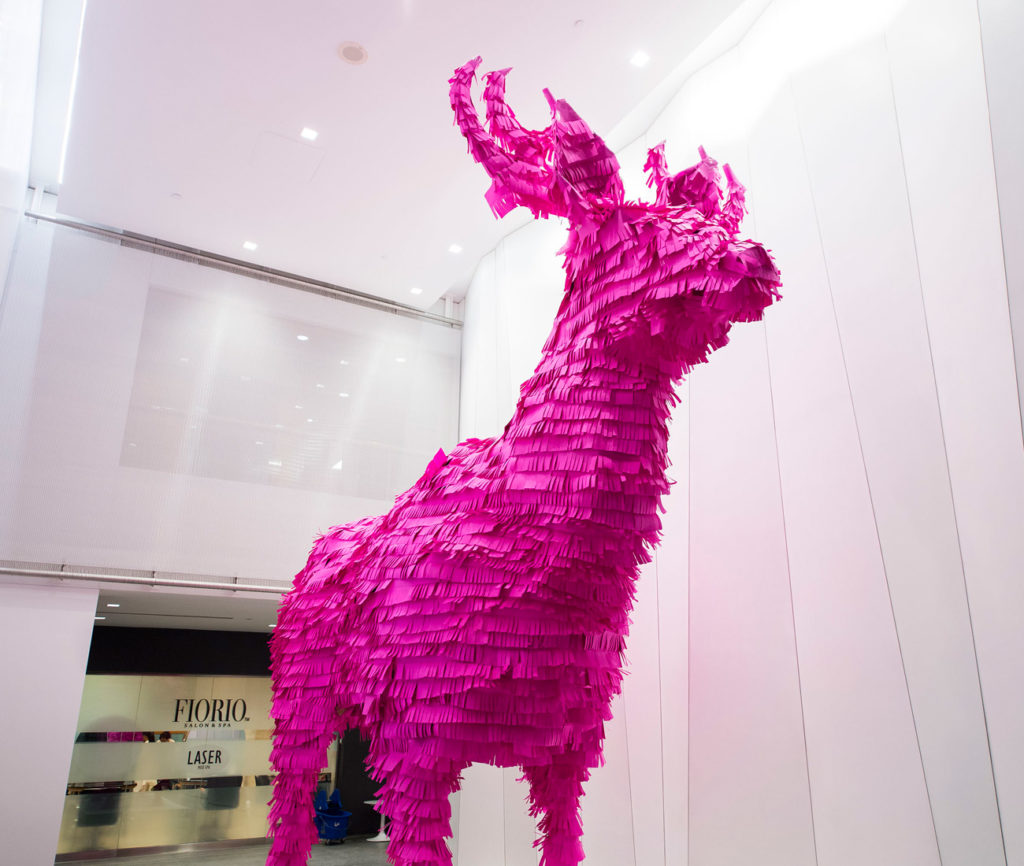 Entitled #ohdeer, global architecture, design, and planning firm, Gensler, deposited a hot pink two-storey tall paper buck in the lobby of a condominium.  A nod to the hooved animals that used to grace and graze the now highly populated area, the piece is in fact a piñata whose contents will spill this weekend. (2 St. Clair Avenue W.)