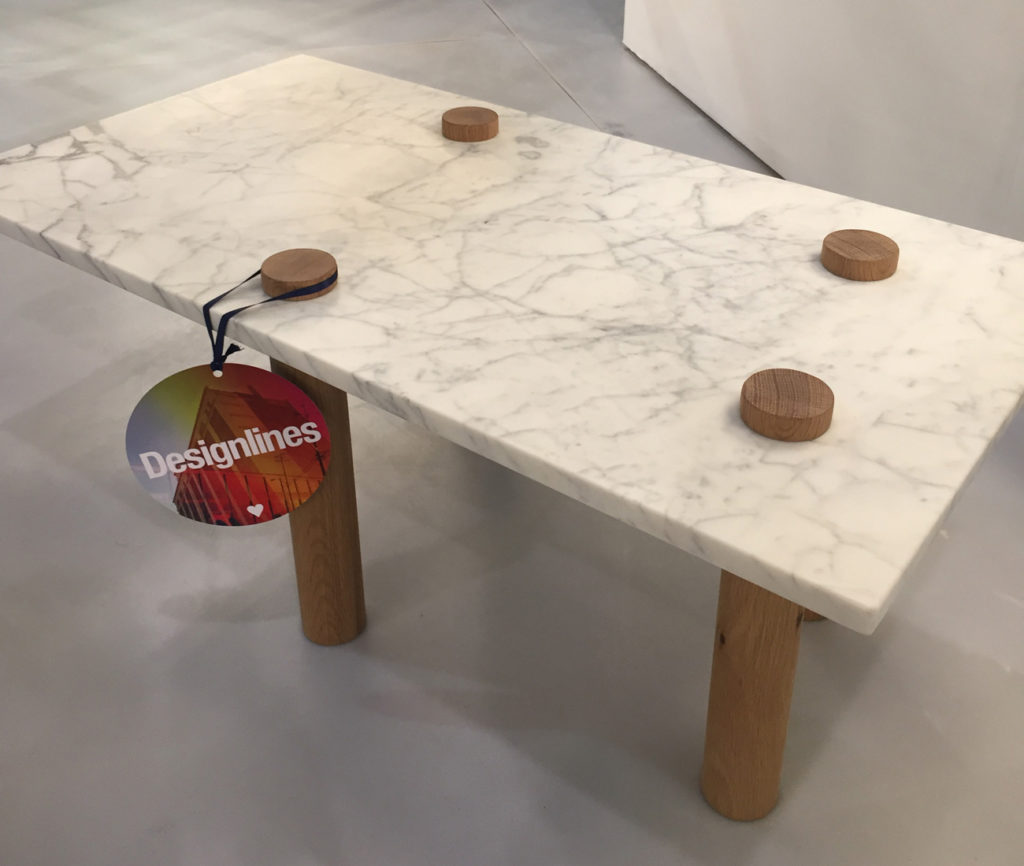 Polar Bear by Hollis + Morris. Bear with him: Just released by Hollis + Morris, the Toronto design studio headed by Mischa Couvrette, this playful marble-top coffee table with cylindrical wooden legs is meant to evoke a polar bear.