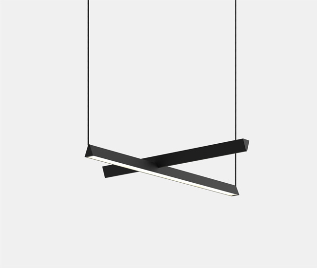 Mile One by Lambert et Fils. We spotted these slender, maroon-coloured light rods in furniture retailer Klaus' beautiful booth. One mile-long light rests on top of the other at a ninety-degree angle. It's the elegant asymmetry that makes the new product shine.