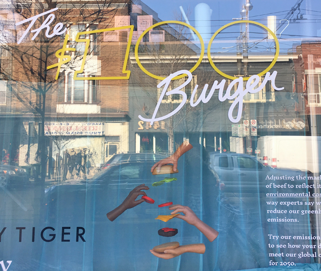 The $100 Burger. How much should we actually be paying for hamburgers? Supermilk Studio's window installation at Easy Tiger Goods answers that question. The bill is a whopping $100. But considering the environmental cost of eating burgers, we should all pay way more at the drive-thru for our fast food addiction. Side note: we love, love the suspended-in-space assembly line created for the window. (1447 Dundas Street West)