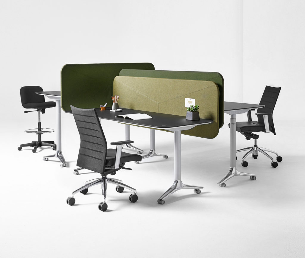 Responding to the increasing demand for standing desks, Nienkämper's Gateway Height Adjustable table allows users to seamlessly change positions with the push of a button.