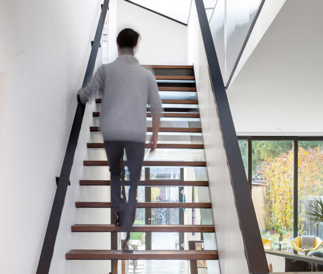The open-tread staircase is at the centre of the house.