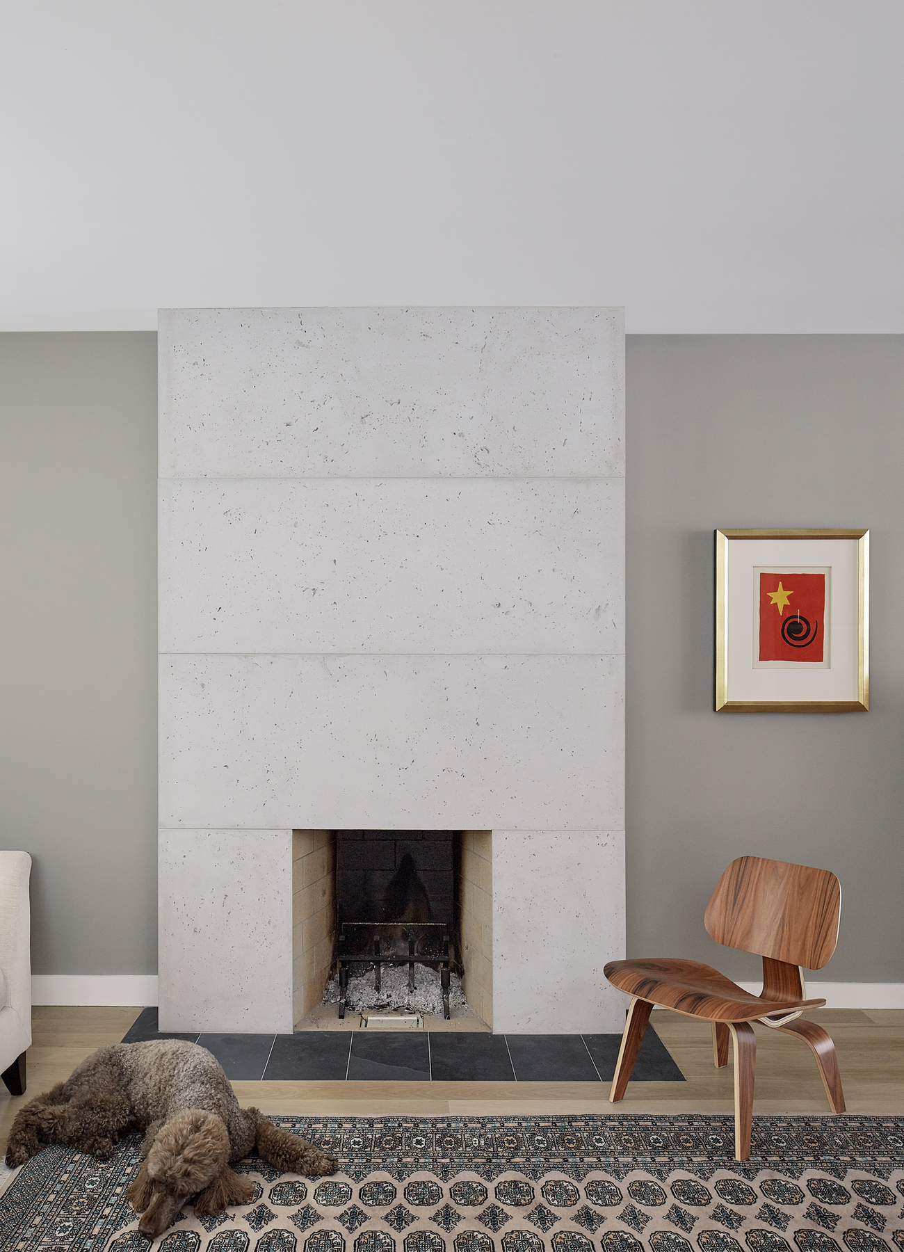The concrete fireplace in House of Louis, a North Toronto renovation by Asquith Architects