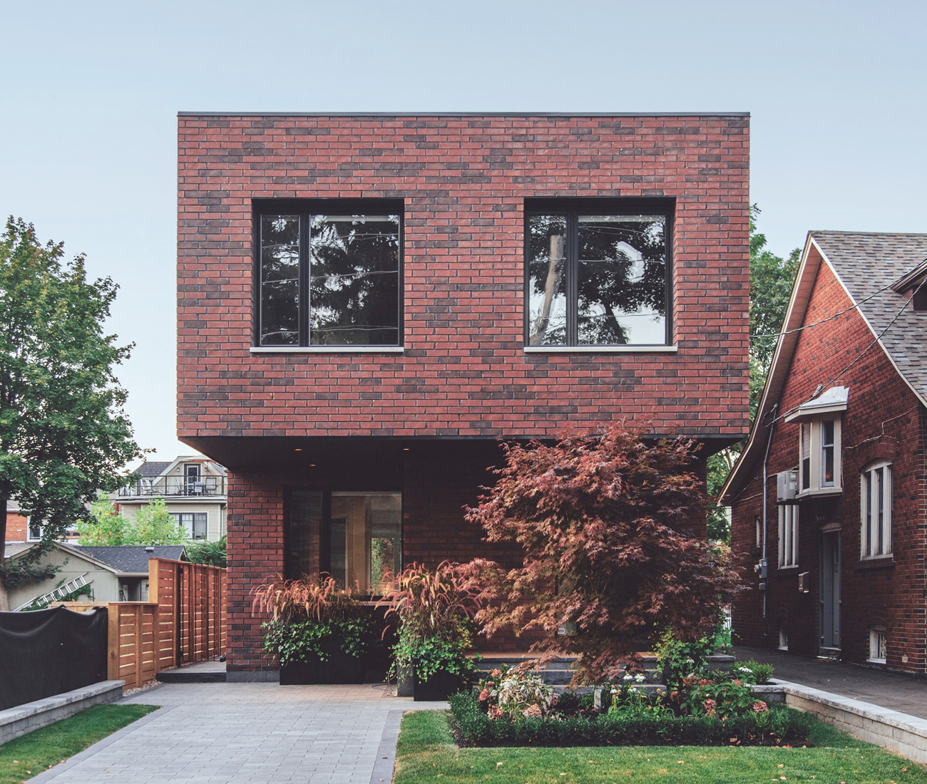Gabriel Fain Architects Brick Cantilever Home Toronto