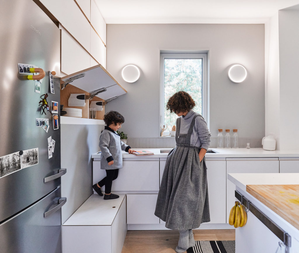 Designed by Saadatpajouh, of Space Animator, and fabricated by Ryan Wilding and Robin Clarke, the kitchen features pure white quartz countertops from Caesarstone and plywood cabinets. Lights by Toronto's Anony; fridge by Miele.